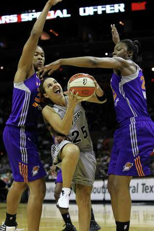 Becky Hammon squeezes under Krystal Thomas (34) and Avery Warley as the San antonio Silver Stars play the Phoenix Mercury at the AT&T Center on  June 1, 2012. Photo: Tom Reel, Express-News / ©2012 San Antono Express-News