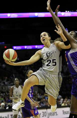Stars guard Becky Hammon scoops a layup under Nakia Sanford as the San antonio Silver Stars play the Phoenix Mercury at the AT&T Center on  June 1, 2012. Photo: Tom Reel, Express-News / ©2012 San Antono Express-News