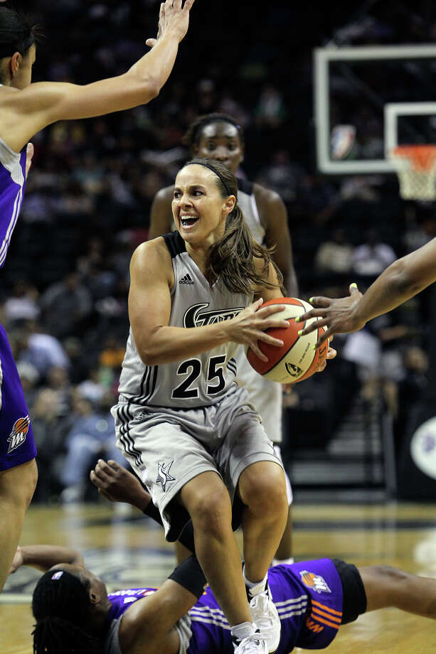 Becky Hammon beats one defender then finds a teammate open on the side as the San antonio Silver Stars play the Phoenix Mercury at the AT&T Center on  June 1, 2012. Photo: Tom Reel, Express-News / ©2012 San Antono Express-News