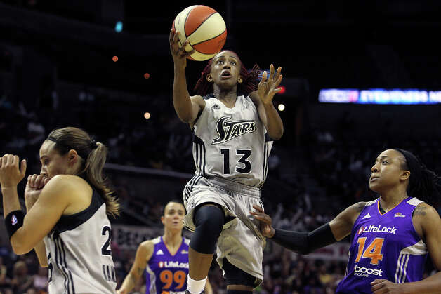 Danielle Robinson finds an opening to the bucket as the San antonio Silver Stars play the Phoenix Mercury at the AT&T Center on  June 1, 2012. Photo: Tom Reel, Express-News / ©2012 San Antono Express-News