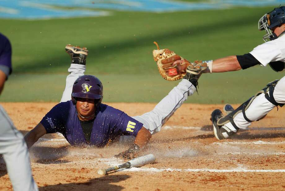 Prairie View A&M's Stef Hernandez, left, slides safely home on a two-run double by Colby Hines in the second inning of the Houston Regional game at Reckling Park. Rice rallied to beat the Panthers 3-2 on Friday. Photo: Karen Warren / © 2012  Houston Chronicle