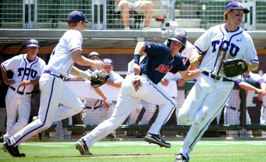 Mississippi's Wil Jamison, center, is tagged out by TCU's Brett Johnson after being caught in a rundown between third and home during the seventh inning. Photo: Stuart Villanueva / Bryan College Station Eagle
