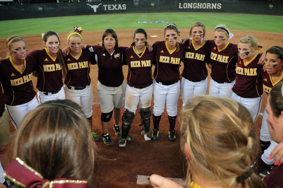Deer Park Head Coach Carrie Austgen, center, leads her team's post-game chat after the Lady Deer's run-rule win over Northside O'Connor during their Class 5A state softball semifinal matchup at Red & Charline McCombs Field in Austin on Friday. Photo: Jerry Baker, For The Chronicle