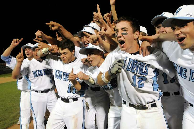 Columbia players celebrate their win 3-2 over Shenendehowa in their Class AA final baseball game on