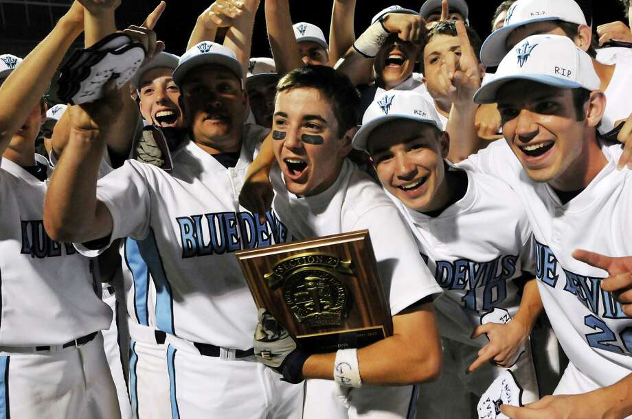 Columbia's Anthony Maney (12), who hit in the winning run in the ninth inning center, holds the plaque as players celebrate their win 3-2 over Shenendehowa in their Class AA final baseball game on Friday, June 1, 2012, at Joseph L. Bruno Stadium in Troy, N.Y.  (Cindy Schultz / Times Union) Photo: Cindy Schultz / 00017858A