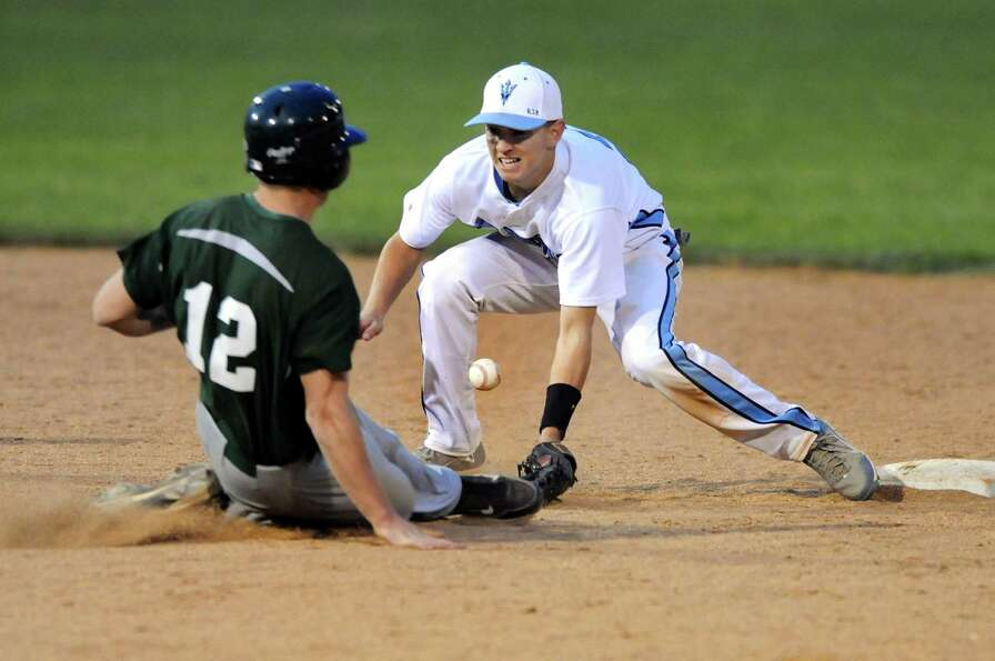 Columbia's shortstop Tyler Hart (2), right, loses the ball and Shenedehowa's Ryan Buss (12) is safe
