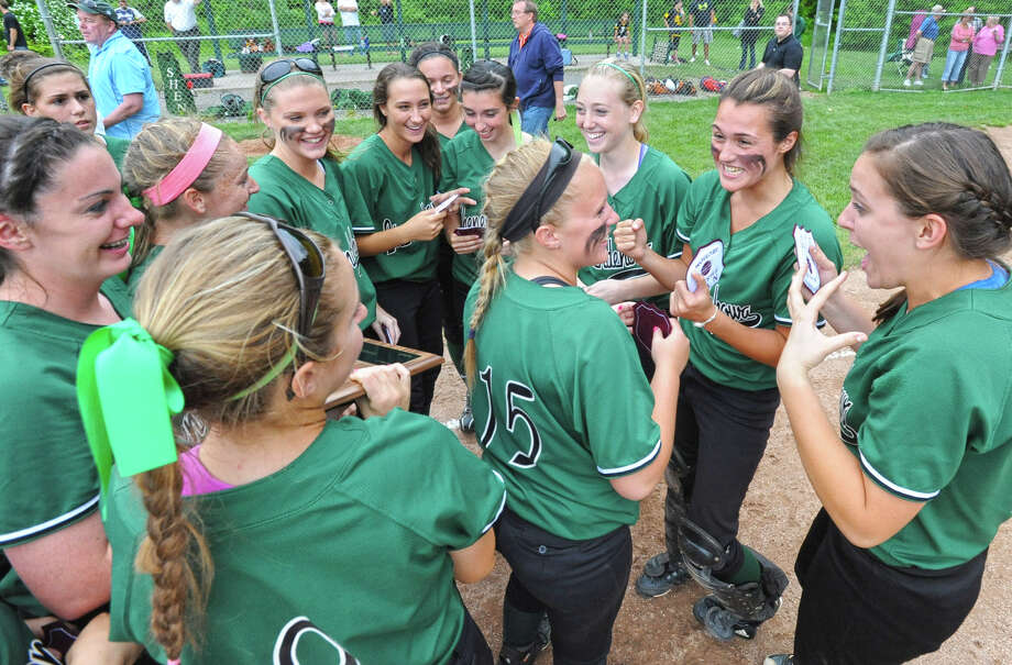 Shenendehowa girls celebrate after defeating Guilderland in the Class AA final softball game  Friday, June 1, 2012 in Colonie, N.Y. (Lori Van Buren / Times Union) Photo: Lori Van Buren