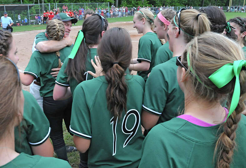 Shenendehowa Head Coach hugs pitcher Erika Daigle as the team celebrates after defeating Guilderland