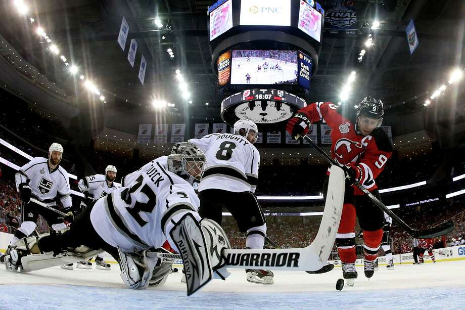 NEWARK, NJ - MAY 30:  Jonathan Quick #32 of the Los Angeles Kings makes a save against Zach Parise #9 of the New Jersey Devils during Game One of the 2012 NHL Stanley Cup Final at the Prudential Center on May 30, 2012 in Newark, New Jersey.  (Photo by Bruce Bennett/Getty Images) Photo: Bruce Bennett