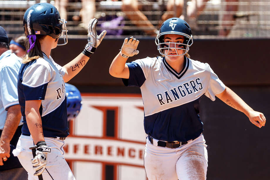 Smithson Valley's Katie Repole (left) congratulates Taylor Darilek after she scored a run during the first inning of their 4A state semifinal game with Waco Midway at McCombs Field in Austin on June 1, 2012.  The Lady Rangers batted around and scored eight runs in the first inning.  Smithson Valley advance to the finals with a 11-9 victory over the Panthers.  MARVIN PFEIFFER/ mpfeiffer@express-news.net Photo: MARVIN PFEIFFER, Express-News / Express-News 2012