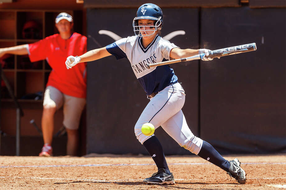 Smithson Valley's Kellen Robles lays down a bunt during the third inning of their 4A state semifinal game with Waco Midway at McCombs Field in Austin on June 1, 2012.  Smithson Valley advance to the finals with a 11-9 victory over the Panthers.  MARVIN PFEIFFER/ mpfeiffer@express-news.net Photo: MARVIN PFEIFFER, Express-News / Express-News 2012