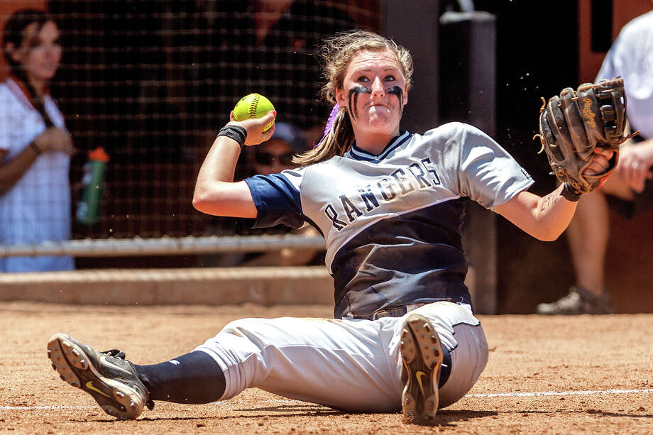 Smithson Valley third baseman Katie Repole throws to first base from the ground during the fifth inning of their 4A state semifinal game with Waco Midway at McCombs Field in Austin on June 1, 2012.  Smithson Valley advance to the finals with a 11-9 victory over the Panthers.  MARVIN PFEIFFER/ mpfeiffer@express-news.net Photo: MARVIN PFEIFFER, Express-News / Express-News 2012
