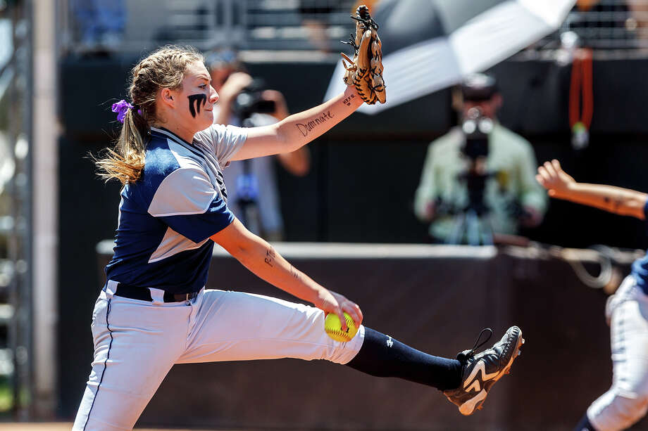 Smithson Valley freshman Regan Mergele winds up for a pitch to the plate during their 4A state semifinal game with Waco Midway at McCombs Field in Austin on June 1, 2012.  Smithson Valley advance to the finals with a 11-9 victory over the Panthers.  MARVIN PFEIFFER/ mpfeiffer@express-news.net Photo: MARVIN PFEIFFER, Express-News / Express-News 2012
