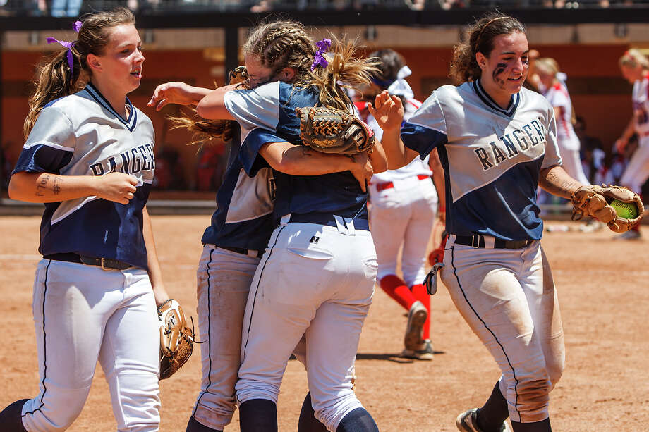 Smithson Valley's Megan Hill (second from left) and Regan Mergele embrace while Brandi Wyrick (left) and Taylor Darilek leave the field after winning their 4A state semifinal game with Waco Midway at McCombs Field in Austin on June 1, 2012.  Smithson Valley advance to the finals with a 11-9 victory over the Panthers.  MARVIN PFEIFFER/ mpfeiffer@express-news.net Photo: MARVIN PFEIFFER, Express-News / Express-News 2012