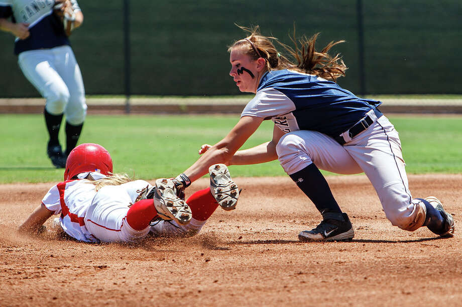 Smithson Valley's Megan Hill (right) tags out Waco Midway's Allison Cooper as she tries to slide back to second base during their 4A state semifinal game with Waco Midway at McCombs Field in Austin on June 1, 2012.  Smithson Valley advance to the finals with a 11-9 victory over the Panthers.  MARVIN PFEIFFER/ mpfeiffer@express-news.net Photo: MARVIN PFEIFFER, Express-News / Express-News 2012