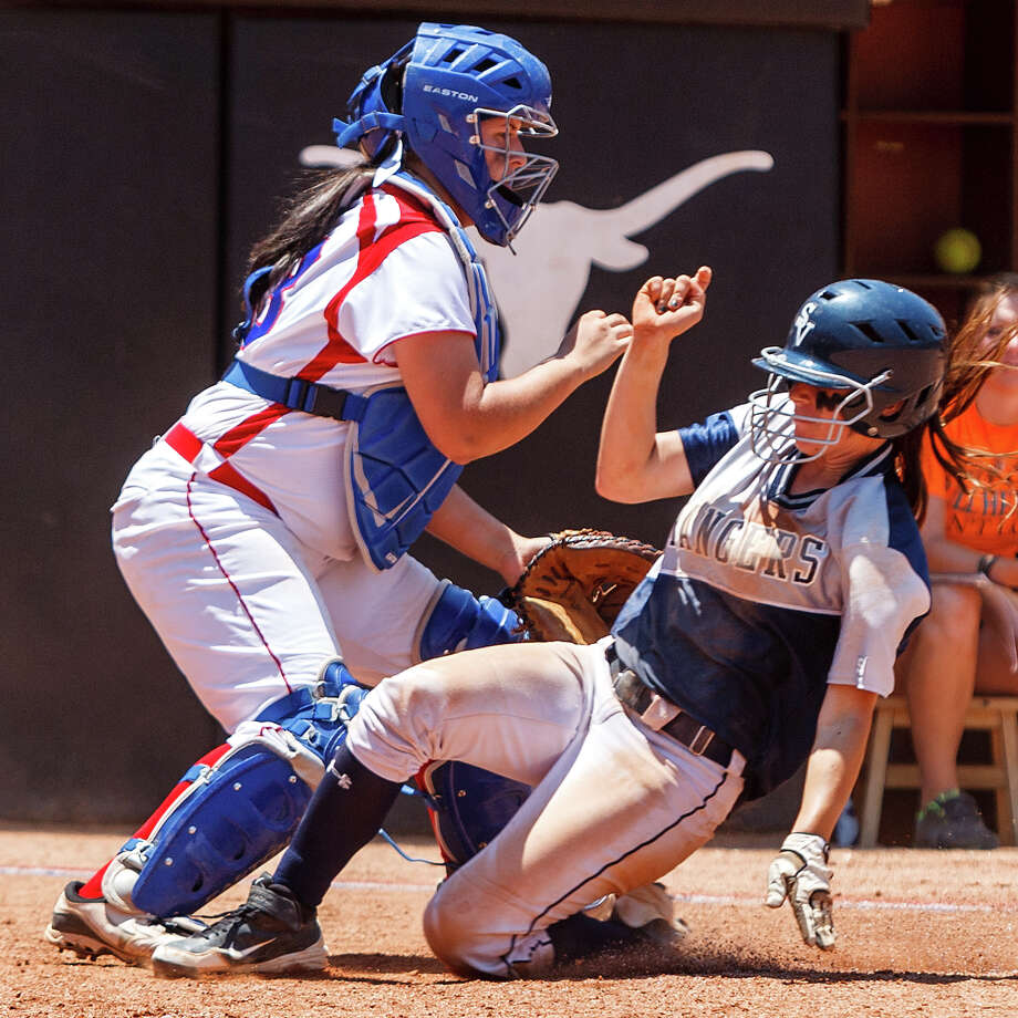 Smithson Vallehy's Megan Hill slides into home plate under Waco Midway catcher Courtney Colunga during the fifth inning of their 4A state semifinal game at McCombs Field in Austin on June 1, 2012.  Smithson Valley advance to the finals with a 11-9 victory over the Panthers. Photo: MARVIN PFEIFFER, Express-News / Express-News 2012