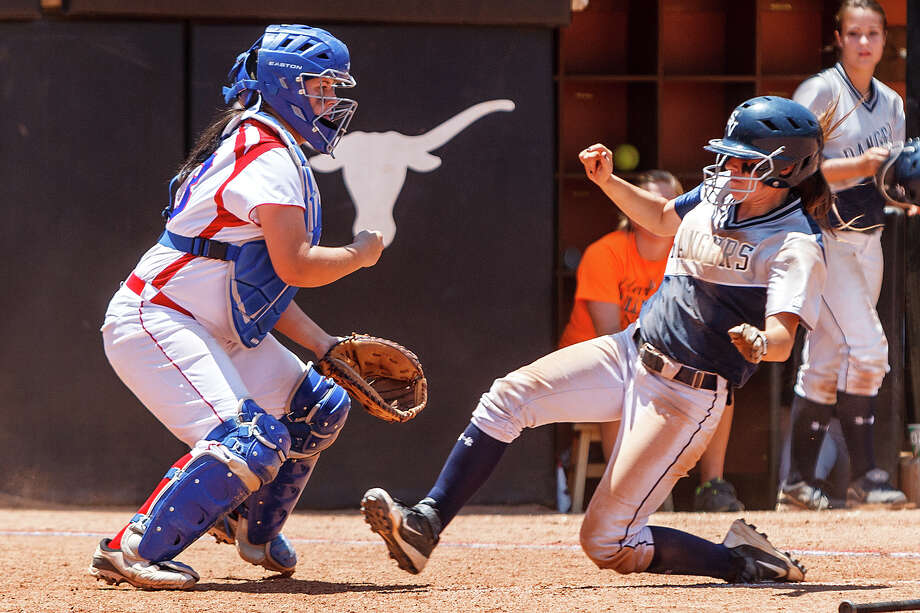 Smithson Vallehy's Megan Hill slides into home plate under Waco Midway catcher Courtney Colunga during the fifth inning of their 4A state semifinal game at McCombs Field in Austin on June 1, 2012.  Smithson Valley advance to the finals with a 11-9 victory over the Panthers.  MARVIN PFEIFFER/ mpfeiffer@express-news.net Photo: MARVIN PFEIFFER, Express-News / Express-News 2012