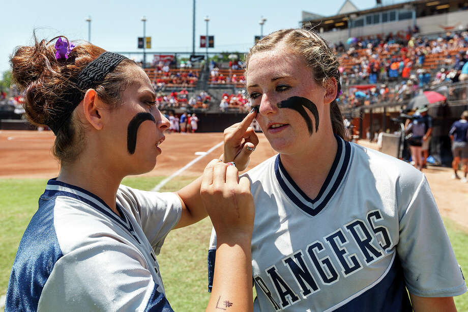"Smithson Valley's Kellen Robles (left) applies face paint to Katie ""Crash"" Repole prior to their 4A state semifinal game with Waco Midway at McCombs Field in Austin on June 1, 2012.  Smithson Valley advance to the finals with a 11-9 victory over the Panthers.  MARVIN PFEIFFER/ mpfeiffer@express-news.net Photo: MARVIN PFEIFFER, Express-News / Express-News 2012"