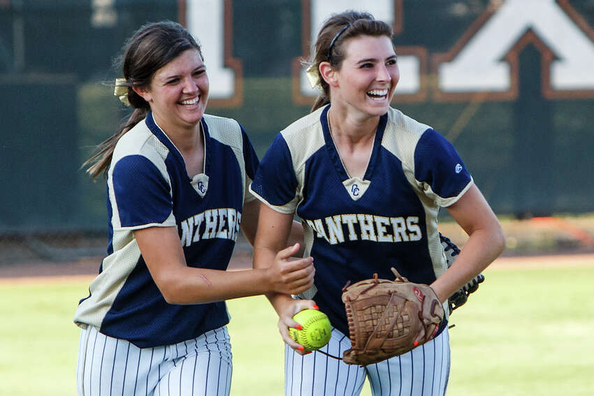 O'Connor's Hannah Fields (left) and Lauryn Donally celebrate after Donnaly's sliding catch to end the top of the third inning during the Lady Panthers' 5A state semifinal game with Deer Park at McCombs Field in Austin on June 1, 2012. Deer Park won the game 13-2 in five innings. MARVIN PFEIFFER/