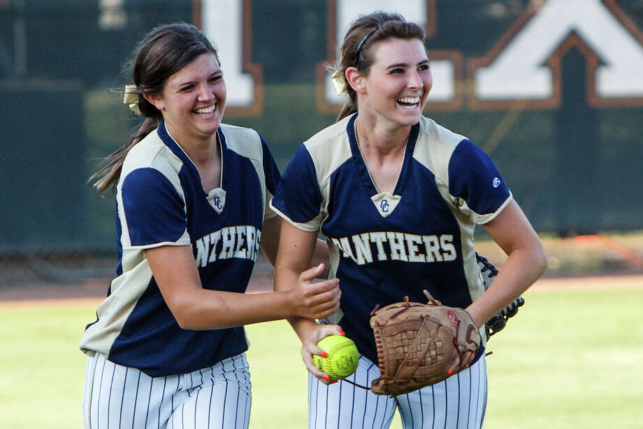 O'Connor's Hannah Fields (left) and Lauryn Donally celebrate after Donnaly's sliding catch to end the top of the third inning during the Lady Panthers' 5A state semifinal game with Deer Park at McCombs Field in Austin on June 1, 2012.  Deer Park won the game 13-2 in five innings.  MARVIN PFEIFFER/ Photo: MARVIN PFEIFFER, Express-News / Express-News 2012