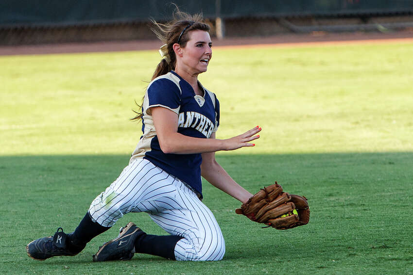 O'Connor left fielder Lauryn Donally makes a sliding catch to end the top of the third inning during the Lady Panthers' 5A state semifinal game with Deer Park at McCombs Field in Austin on June 1, 2012. Deer Park won the game 13-2 in five innings. MARVIN PFEIFFER/ mpfeiffer@express-news.net