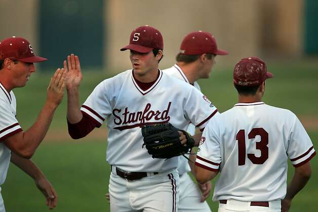 Mark Appel is greeted with high-fives from his team mates as he returns to the Stanford dugout on Friday during the game versus Fresno. Stanford met Fresno at Sunken Diamond on Friday for the NCAA Regional. Photo: Kevin Johnson, The Chronicle