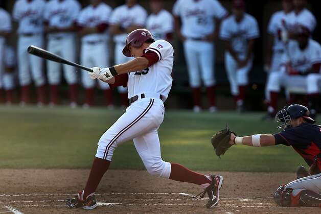 Stephen Piscotty lunges the bat at the ball on Friday during the NCAA regional game versus Fresno. Stanford met Fresno at Sunken Diamond on Friday for the NCAA Regional. Photo: Kevin Johnson, The Chronicle