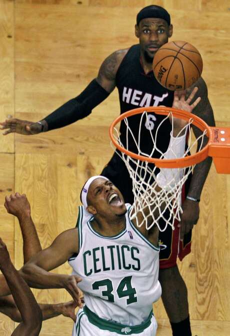Miami's LeBron James has a ringside seat as Boston's Paul Pierce (34) drives hard to the basket in the third quarter Friday night for two of his 23 points. Photo: Charles Krupa / AP