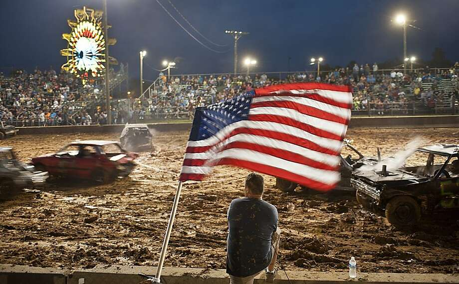 Fans watch the demolition derby Thursday, May 31, 2012, in Danville, KY., during the Boyle County Fair. (AP Photo/Clay Jackson, Advocate Messenger) Photo: Clay Jackson, Associated Press