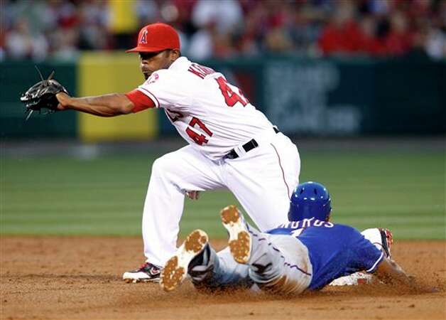 Texas Rangers' Elvis Andrus is safe at second with a stolen base as Los Angeles Angels second baseman Howie Kendrick (47) is late with the tag in the third inning of a baseball game in Anaheim, Calif., on Friday, June 1, 2012. (AP Photo/Christine Cotter) Photo: Associated Press