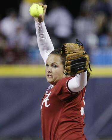 Alabama's Jackie Traina pitches against Arizona State in the first inning of an NCAA Women's College World Series softball game in Oklahoma City, Friday, June 1, 2012. (AP Photo/Sue Ogrocki) Photo: Sue Ogrocki, Associated Press