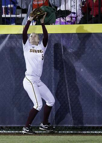 Arizona State center fielder Elizabeth Caporuscio catches a fly ball hit by Alabama's Kaila Hunt for an out in the third inning of an NCAA Women's College World Series softball game in Oklahoma City, Friday, June 1, 2012. (AP Photo/Sue Ogrocki) Photo: Sue Ogrocki, Associated Press