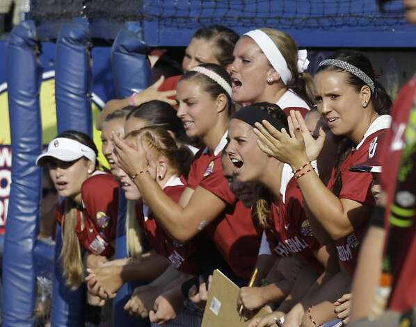 Oklahoma players cheer in the dugout in the first inning of an NCAA Women's College World Series softball game against California in Oklahoma City, Friday, June 1, 2012. Oklahoma won 3-0. (AP Photo/Sue Ogrocki) Photo: Sue Ogrocki, Associated Press