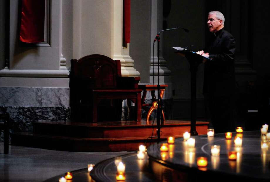 St. James Pastor Fr. Michael Ryan says a few words at the beginning of a prayer service at St. James Cathedral for the victims of Wednesday's  shootings on Friday, June 1, 2012. Photo: LINDSEY WASSON, Lindsey Wasson / SEATTLEPI.COM