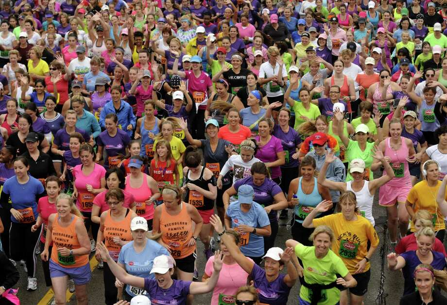Runners break from the staring line during the 2012 Freihofer's Run for Women in Albany N.Y. Saturday June 2, 2012. (Michael P. Farrell/Times Union) Photo: Michael P. Farrell