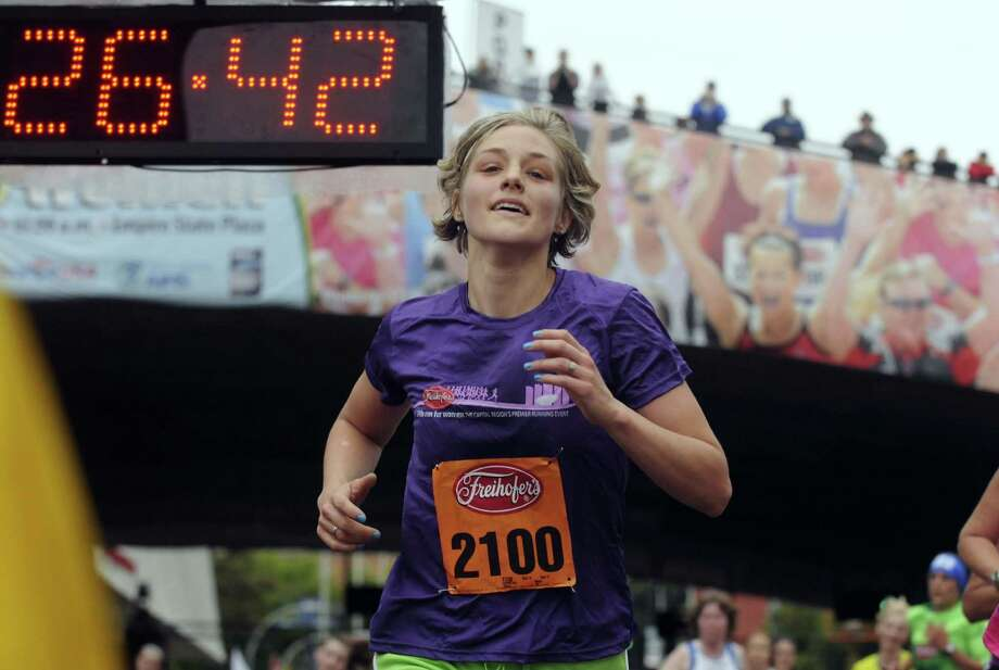 Megan Schmidt Root of Albany crosses the finish line during the 34th annual Freihofer's Run for Women in Albany N.Y. Saturday June 2, 2012. (Michael P. Farrell/Times Union) Photo: Michael P. Farrell