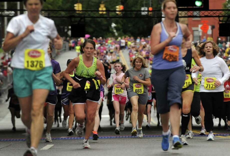 Women runners of all walks head to the finish line during the 34rd annual Freihofer's Run for Women in Albany N.Y. Saturday June 2, 2012. (Michael P. Farrell/Times Union) Photo: Michael P. Farrell