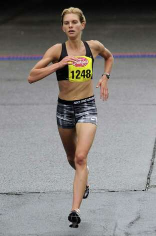 Nicole Irving was the top local runner finishing 16th in the34rd annual Freihofer's Run for Women in Albany N.Y. Saturday June 2, 2012. (Michael P. Farrell/Times Union) Photo: Michael P. Farrell