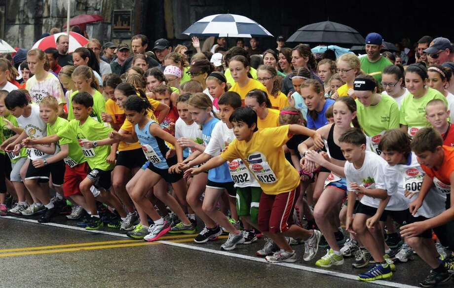 Children break from the start of the junior 3K portion of the 34rd annual Freihofer's Run for Women in Albany N.Y. Saturday June 2, 2012. (Michael P. Farrell/Times Union) Photo: Michael P. Farrell