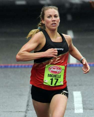 Michelle Frey finishes sixth in the 34rd annual Freihofer's Run for Women in Albany N.Y. Saturday June 2, 2012. (Michael P. Farrell/Times Union) Photo: Michael P. Farrell