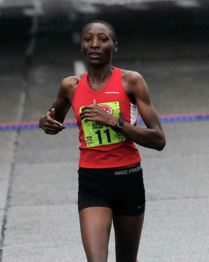 Risper Gesabwa finishes fourth in the 34rd annual Freihofer's Run for Women in Albany N.Y. Saturday June 2, 2012. (Michael P. Farrell/Times Union) Photo: Michael P. Farrell