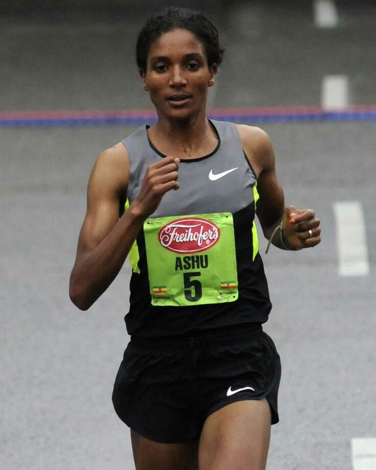 Ashu Kasim finishes second in the 34rd annual Freihofer's Run for Women in Albany N.Y. Saturday June 2, 2012. (Michael P. Farrell/Times Union) Photo: Michael P. Farrell