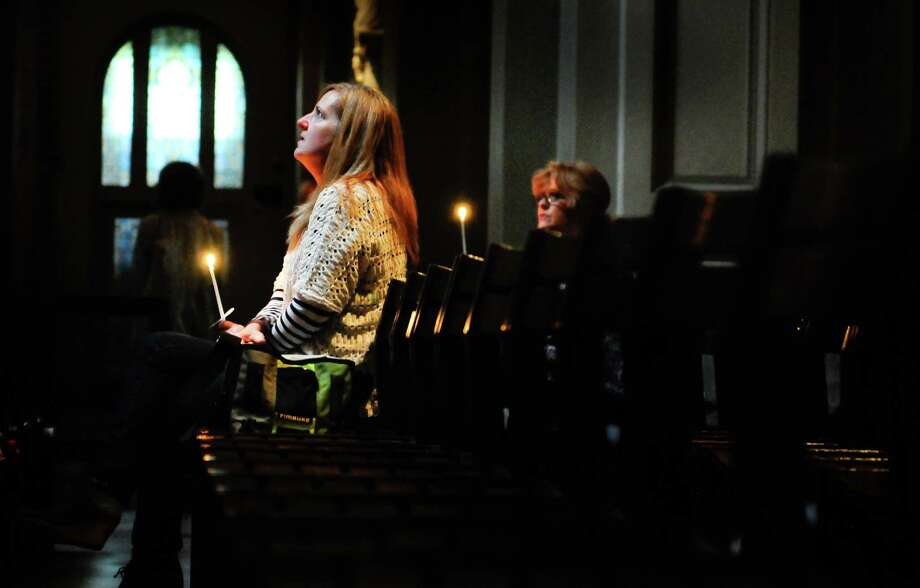 Suzanne Mercier, a close friend of Cafe Racer owner Kurt Geissel, looks upwards during a prayer service at St. James Cathedral for the victims of Wednesday's  shootings on Friday, June 1, 2012. Six people, including shooter Ian Stawicki, died after Stawicki killed a woman at 8th Avenue and Seneca and later opened fire at Cafe Racer. Photo: LINDSEY WASSON / SEATTLEPI.COM