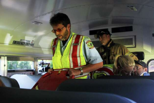 Lumberton ISD initiated a mock bus accident in the early morning hours Friday, June 1. The drill helped bus drivers, transportation and administrative personel better prepare for an actual emergency. Photo: David Lisenby, HCN_Mock 2