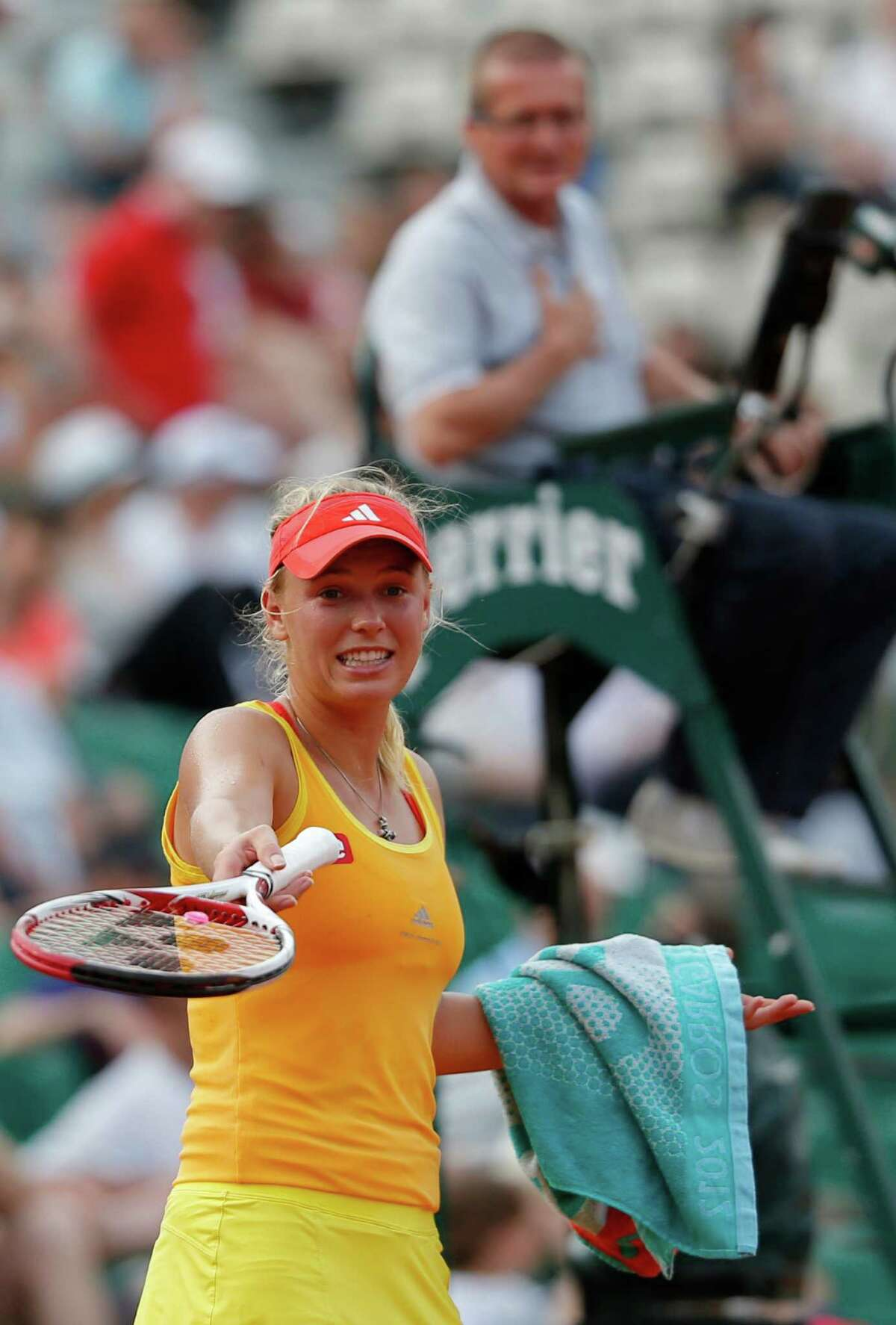Caroline Wozniacki argues with chair umpire Poncho Ayala during her third-round loss to Kaia Kanepi. The former top-ranked Dane described the officiating Saturday as a