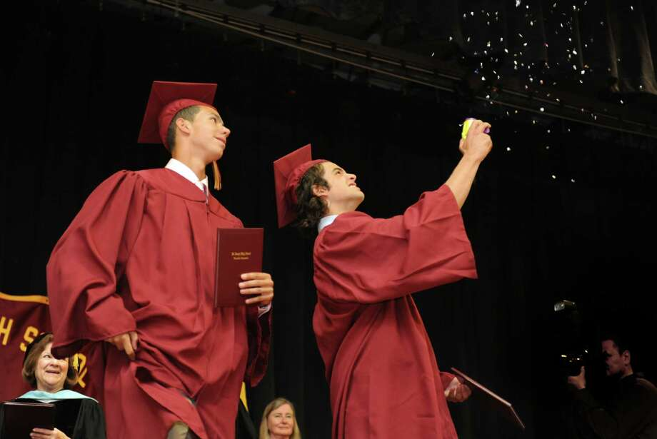 St. Joseph High School graduates Jon Vazquez, of Bridgeport, and Matt Vazzano, of Milford, celebrate during commencement exercises Saturday, June 2, 2012 at the school in Trumbull, Conn. Photo: Autumn Driscoll / Connecticut Post