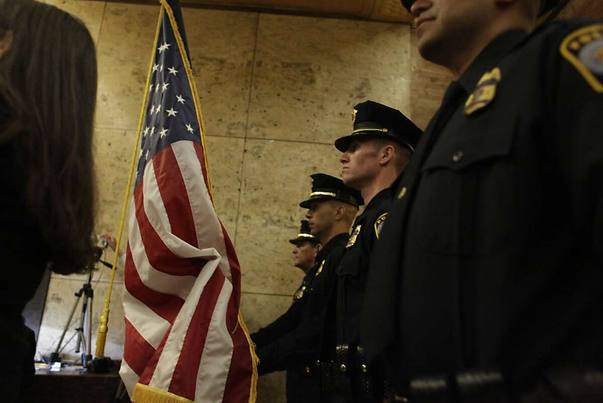 Honor Guard of the San Francisco Mint Police prepare for the Presentation of Colors during a ceremony in the lobby at the United States Mint in San Francisco on it's 75th Anniversary of the Hermann Street Facility on Tuesday, May 15, 2012 in San Francisco, Calif.