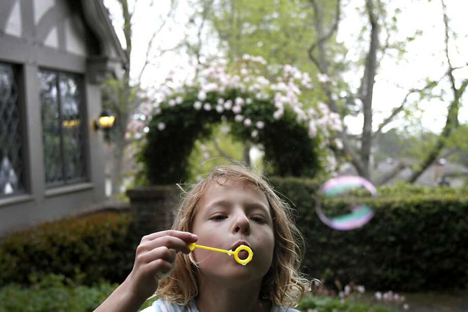 Taylor Rolefson, 6, blows bubbles in her yard in Piedmont, Calif., Thursday, May 3, 2012.  Taylor has cystic fibrosis and is under the care of doctors at UCSF, who have made huge gains in the past decade in how they treat cystic fibrosis. Photo: Sarah Rice, Special To The Chronicle