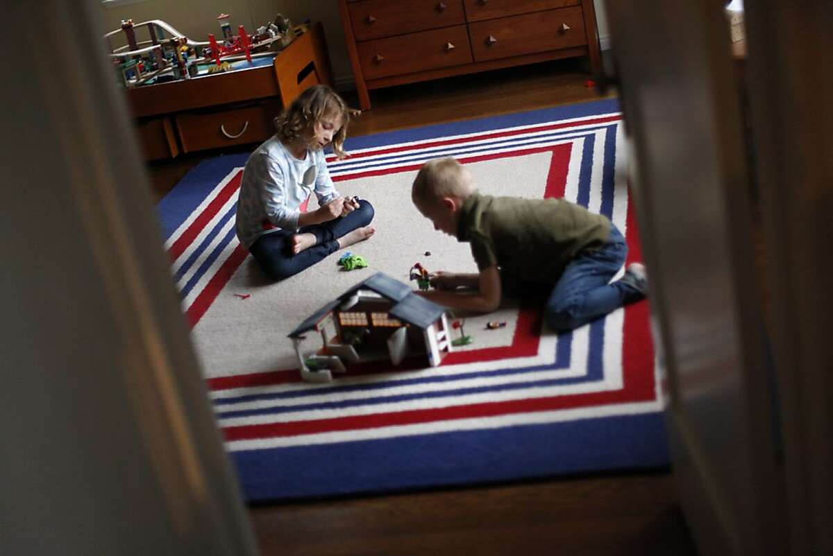 Twins Taylor, left, and Tom Rolefson, 6, play at home in Piedmont, Calif., Thursday, May 3, 2012. Taylor has cystic fibrosis and is under the care of doctors at UCSF, who have made huge gains in the past decade in how they treat cystic fibrosis.