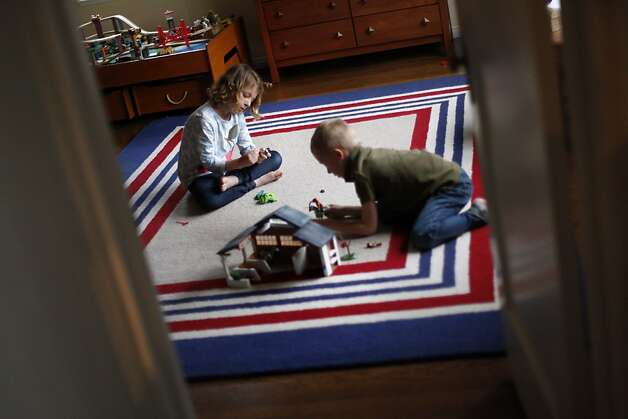 Twins Taylor, left, and Tom Rolefson, 6, play at home in Piedmont, Calif., Thursday, May 3, 2012.  Taylor has cystic fibrosis and is under the care of doctors at UCSF, who have made huge gains in the past decade in how they treat cystic fibrosis. Photo: Sarah Rice, Special To The Chronicle